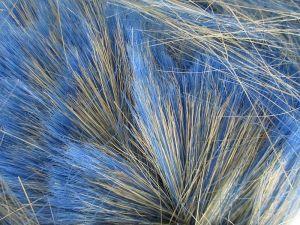 A bunch of acrylic fibers, some of which have been dyed a dull blue.