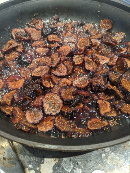 Sliced dried figs cooking on the stove top.