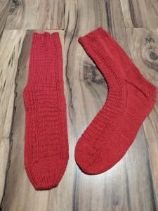 Red hand-knit socks.