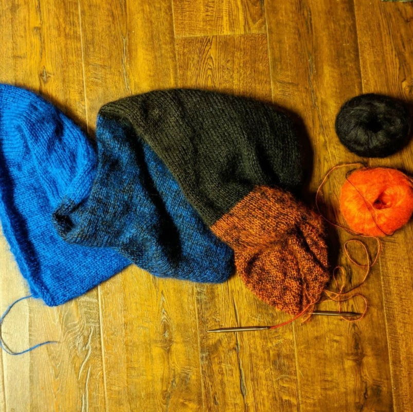 In progress Cold Spring shawl. The fourth strip (orange black) is currently being worked on.