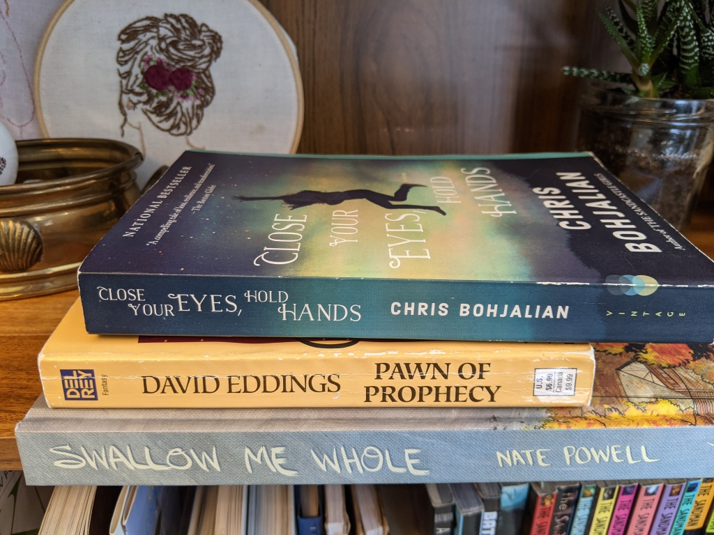Spines of three books to create a poem, see caption for author and titles