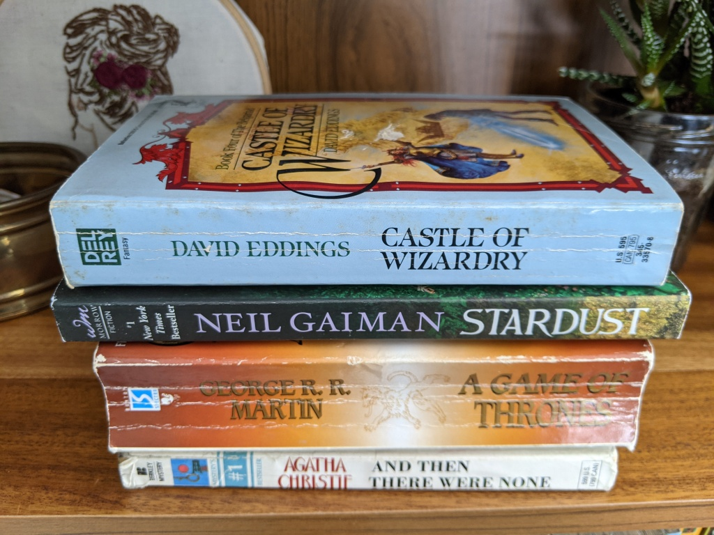 Spines of four books to create a poem, see caption for author and titles
