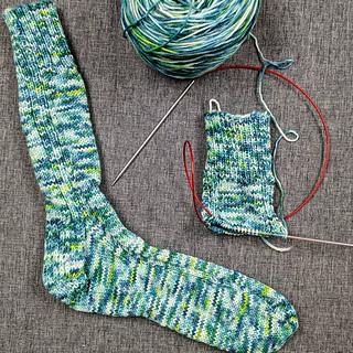 Green, blue variegated knit socks.