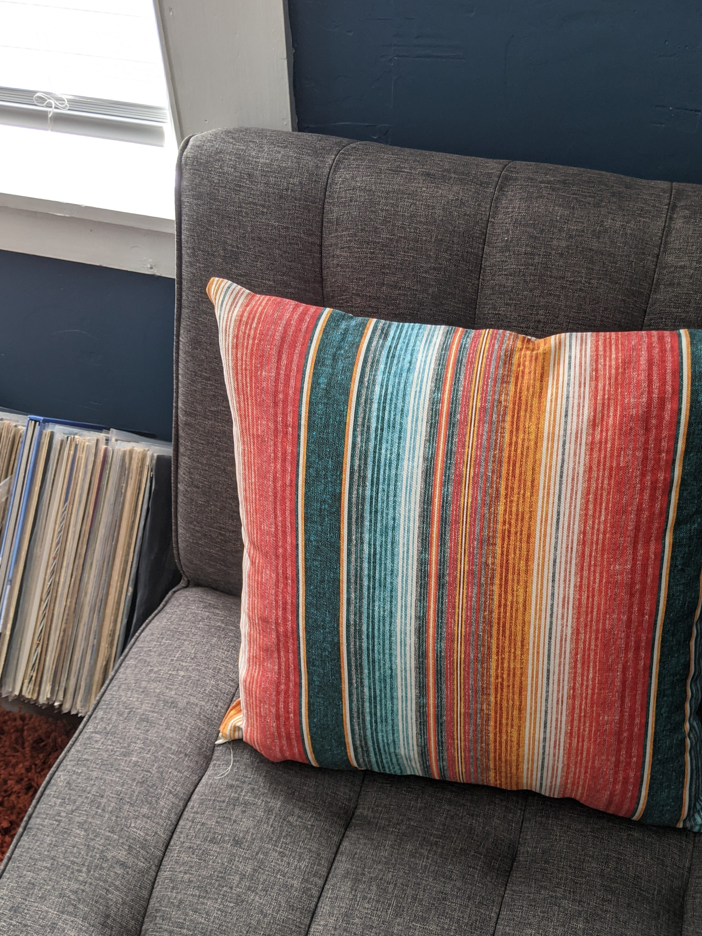 Multi colored striped throw pillow